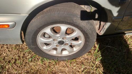 03 rodas l/leve volvo s40 c/pneu semi novo original,