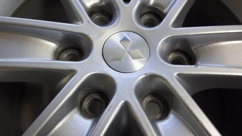 04 calotinhas centrais mitsubishi l200 triton roda aro 16 #1
