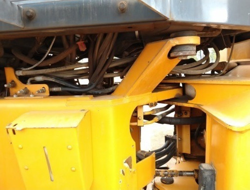 18) cargador frontal / trascavo case 721c 2000