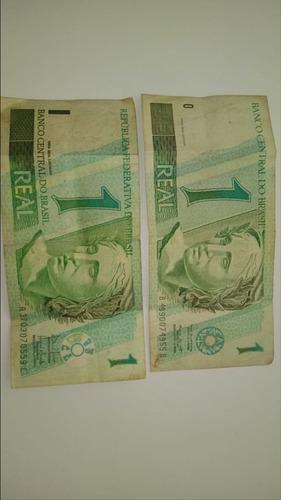 2 cédulas de 1$,conservadas.