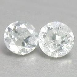2 diamantes si, h  .04 quilates