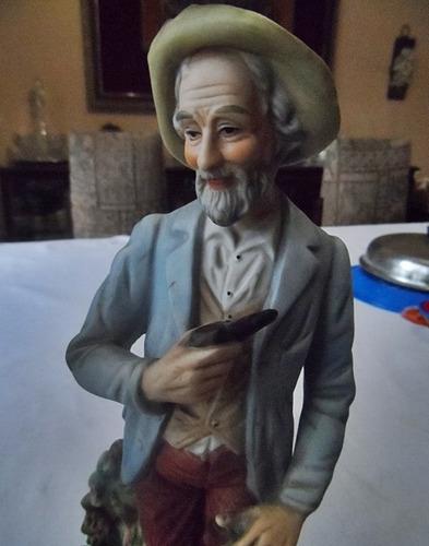 2 figuras de porcelana ancianos