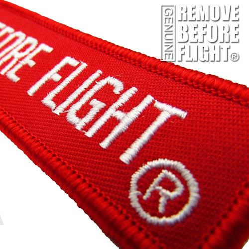 2 llaveros  moto remove before flight ®