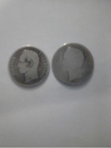 2 monedas de un  bolívar.