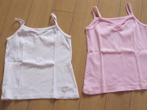 2 musculosas rosa y blanca t: 6 años, poco uso