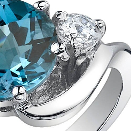 3 stone design 2.25 quilates london topaz blue ring en plata