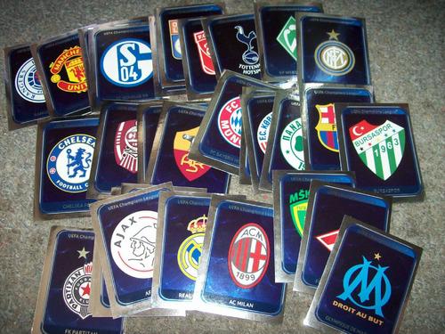 32 figuritas escudos champions league 2010-11 diferentes