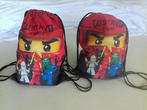 50 mochilas / bolsas /sacolas super herois tam 25x35