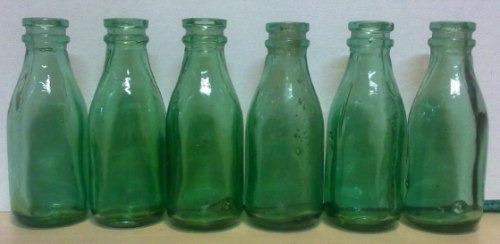 6  mini botellitas de leche vacias