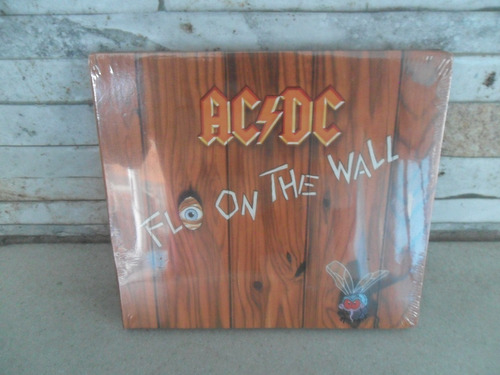 Acdc = Flo On The Wall . Cd . Lacrado