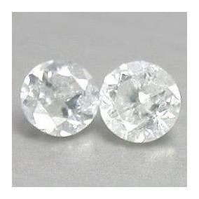2 Diamantes H .22 Quilates