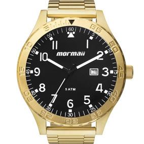 e24b3f2ce1e Relógio Mormaii Masculino Flip Dourado E Preto Mo2115an 4p