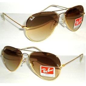 Réplica Ray Ban Aviador Armação Dourada E Lente Marrom - Óculos no ... 6d644028b5