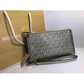 0b792bf1e4f0e Carteira Michael Kors Pale Gold Modelo Jet Ser Travel