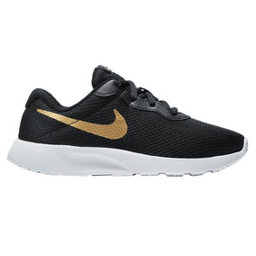 recognized brands beauty los angeles cheap nike tanjun negro and oro fbe84 6b525