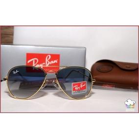 Ray-ban Aviador Dourado Lente Safira Azul Degradê Original. 59. São Paulo ·  Óculos Escuros Aviador Médio Rb3025 Lente Azul Degradê 02ae785558