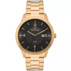 2b84ec1349d7a Relogio Technos Masculino Dourado E Preto - Relógios De Pulso no ...