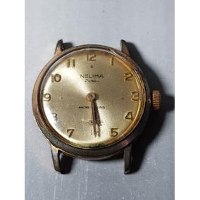 f06afdaa02d Relógio Pulso Nelima - Dourado Corda - Antigo - Funcionando