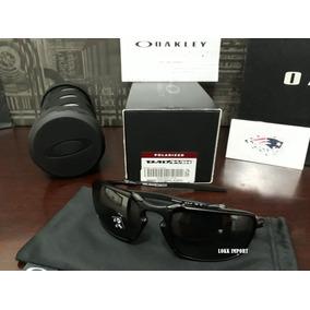 Oakley Badman Dark Carbon Black Iridium Polarized - Óculos no ... 00815105ce