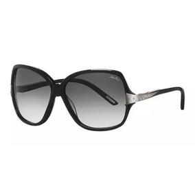 7165b9695ddee Óculos De Sol Nina Ricci   3227 01 Acetato Preto Lente Cinza