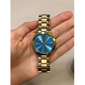 Relogio Michael Kors Dourado Com Fundo Azul - Relógio Michael Kors ... 2b595684eb