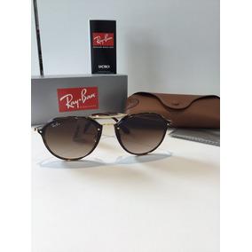 067bfe56a1d82 Óculos De Sol Prada Spr24n Light Havana 4bw6s1 - Óculos De Sol no ...