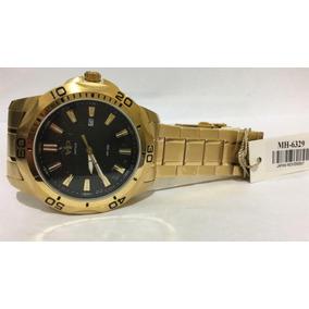 81229949fad Relogio Vip Dourado Com Calendario Mh 12c - Relógios no Mercado ...