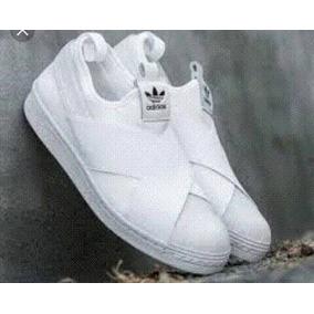 separation shoes bad1a 6cea6 Zapatos adidas Slip On Blancos Originales Nuevos Unisex