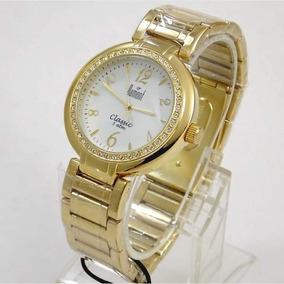 0be5ed52ef5 Relógio Dourado Dumont Feminino Branco Clássico Com Cristais ...