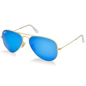 Óculos Ray Ban 3025 112 17 Lente Azul Espelhado Armação Gold ... 9a8f1a02aa