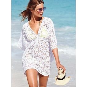 Vestidos blancos en la playa