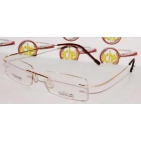 55040e6b15c4c Armação Oculos De Grau Titanium Sem Aro Dourada Silhouette - Óculos ...