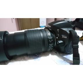 Câmera Nikkon D5100 - Lente 18x105 - Bolsa Multifuncional