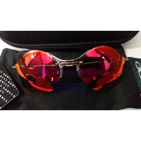 3a906b0ba15e1 Óculos Redondo Prata Com Lentes Espelhadas Oakley - Óculos no ...