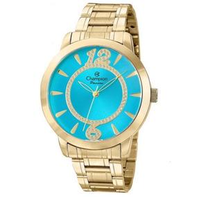 1cf6913752e Relogio Feminino Dourado Fundo Azul Turquesa - Relógios De Pulso no ...