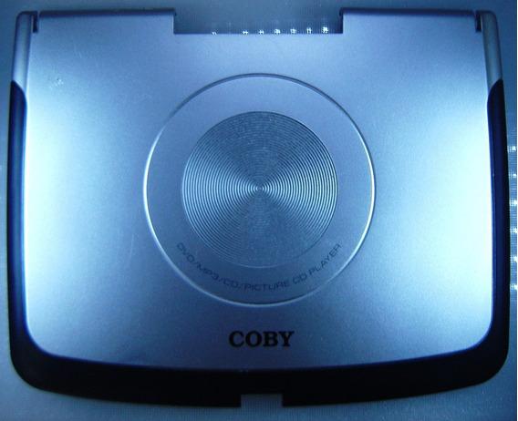Coby Tf-dvd7500 - Tampa Do Lcd Prata Com Bordas Em Preto