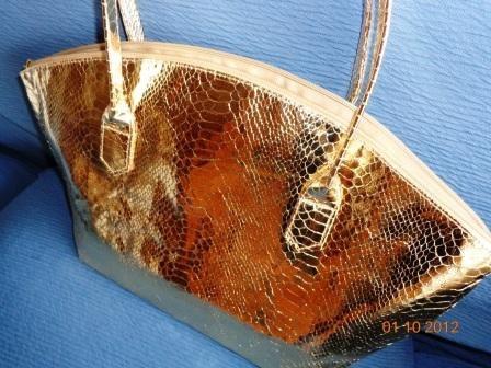 Bolsa Elizabeth Arden Dourada Ziper Tecido Alça Longa Oval