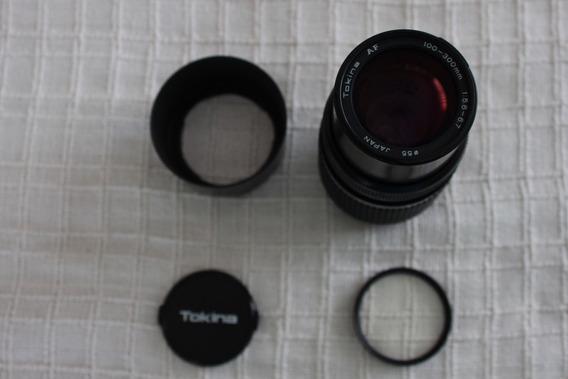Objetiva Tokina 100/300mm 5.6-6.7 Para Canon