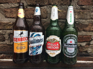 12 Envases De Cerveza Quilmes Stella Heineken Isenbeck