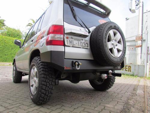 Imagem 1 de 6 de Para-choque Traseiro Para Mitsubishi Pajero Io Tr4 Até 2009