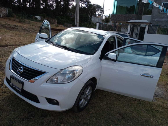Versa 2013 Blanco. Advance Tm. A/c