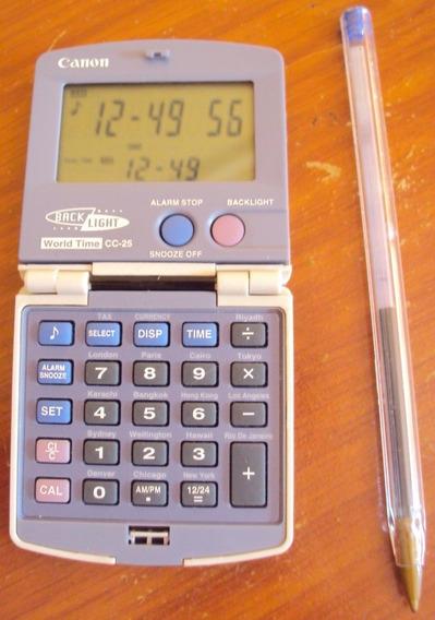 080 Prd- Um Antigo Relógio E Calculadora Canon