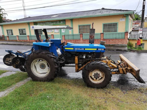 Tractor New Holland 6610 - 4x4 - Carraro - Modelo 2002