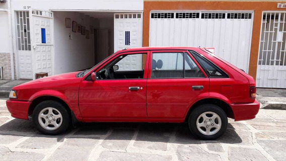 Mazda 323 Motor 1.3 2004 Rojo 5 Puertas