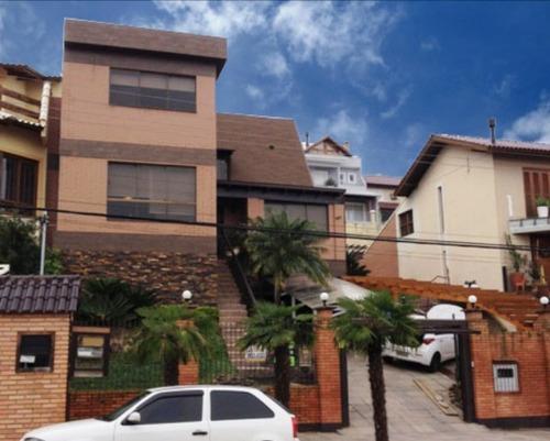 Casa Em Ipanema Com 4 Dormitórios - Mi5493