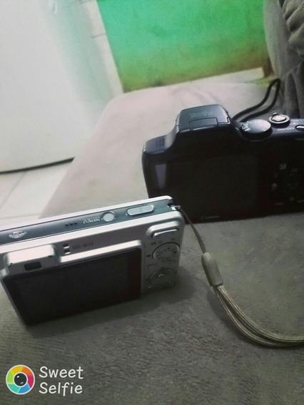 Câmara Da Marca Canon E Uma Câmara Sony Falta O Carregador