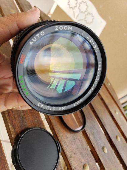 Objetiva Sakar Mc Auto Zoom 1:4.0-5.6 F=60-300mm Canon Fd