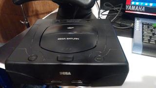 Sega Saturn(usa) + 3joystics + Pistola + Volante + Juegos