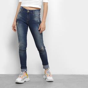 254ee70e05 Calça Jeans Skinny Dimy Selena Rasgos Cintura Média Feminina