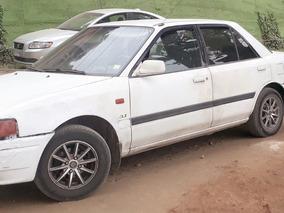 Vehiculo Blanco, Mazda 323glx